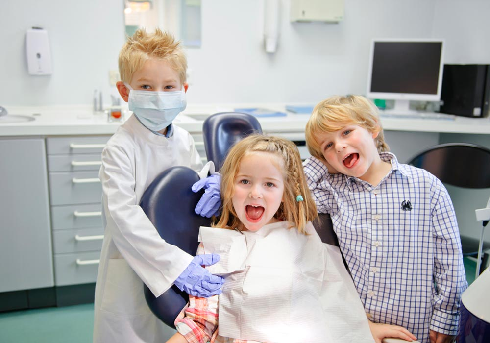 Children Smiling in Dental Clinic - Aurora Pediatric Dentist